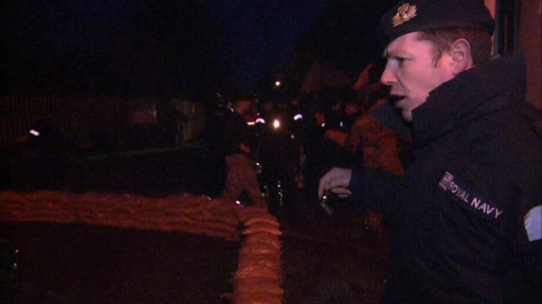 Sandbag wall put down by Navy in Datchet, Berkshire, amid flood fears