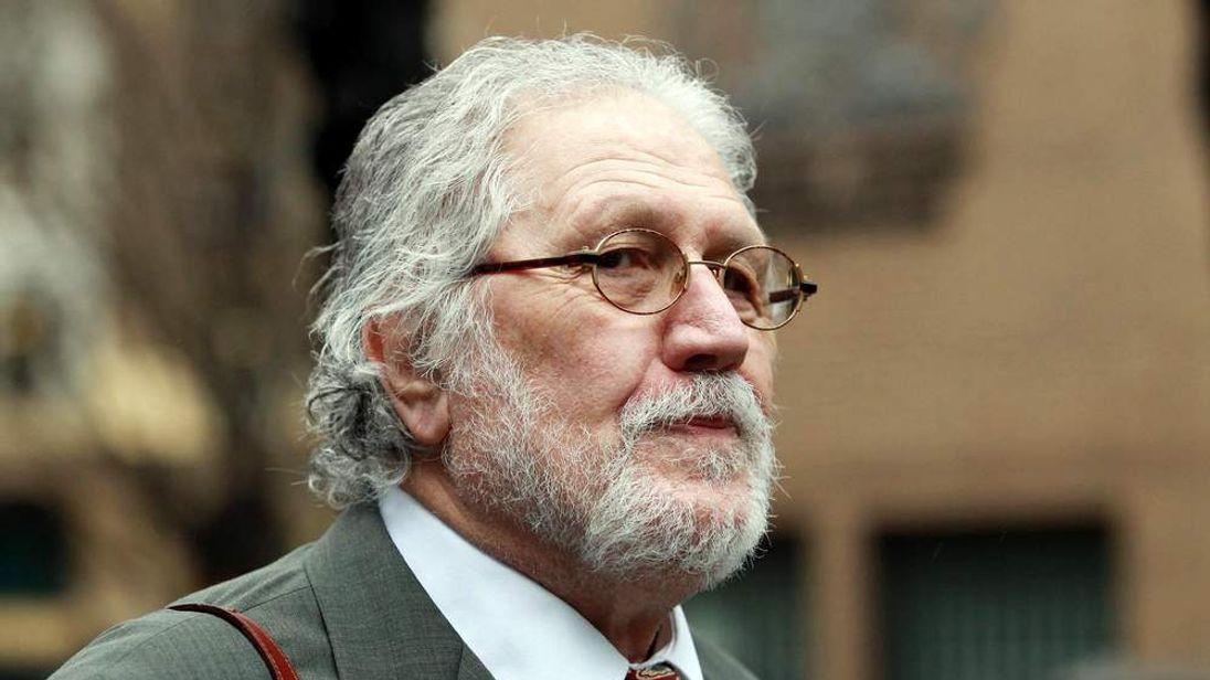 Former DJ Dave Lee Travis arrives at Southwark Crown Court in London