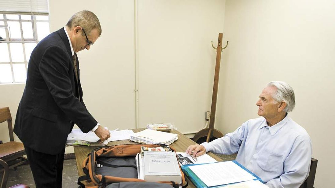 Bruce Davis, right, a former member of the Manson Family, meets with his lawyer