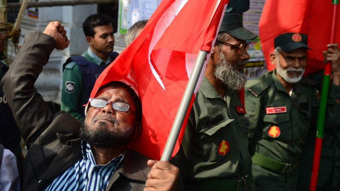 An activist shouts slogans outside Bangladesh's International Crimes Tribunal where a TV cleric was sentenced to death for war crimes