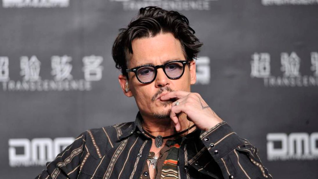 "Actor Johnny Depp attends a promotional event of his new movie ""Transcendence"" in Beijing"