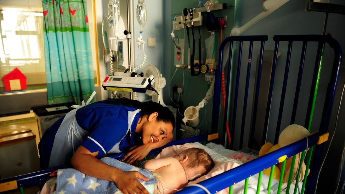 Sister Melissa Strickland with 19-month-old Harley Frakes on the neurosurgery ward at Great Ormond Street Hospital, pictured in 2008
