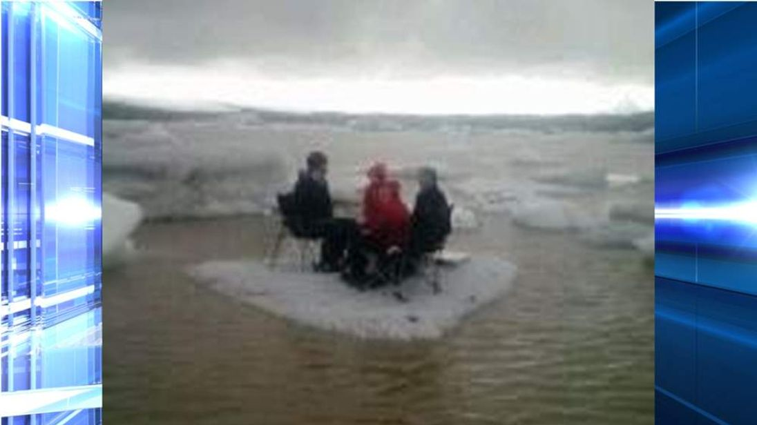 A group of American tourists eating lunch on an iceberg