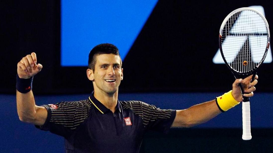 Novak Djokovic of Serbia celebrates defeating Andy Murray of Britain in their men's singles final match at the Australian Open tennis tournament in Melbourne