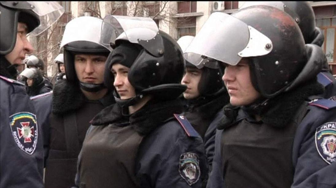 Police push pro-Russian supporters out of government buildings in Donetsk