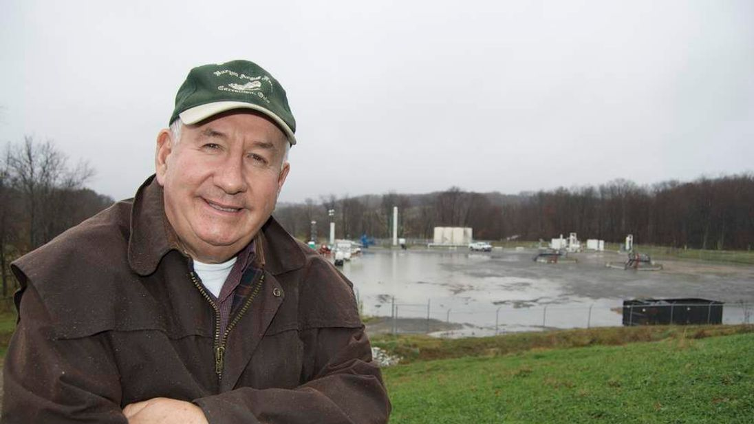 Keith Burgett at the site of a gas well on his land.