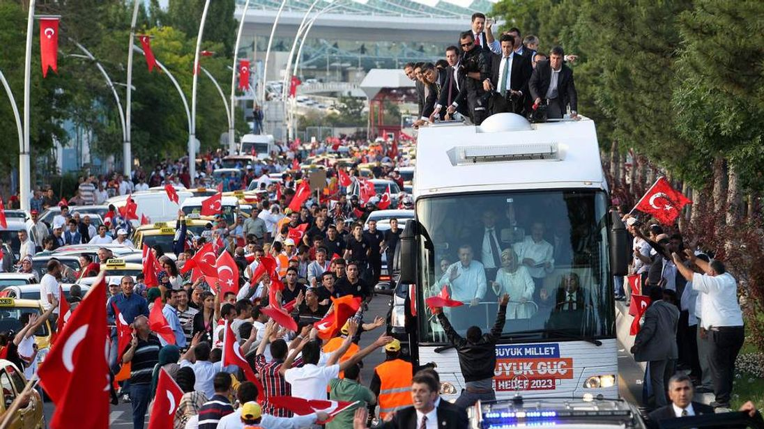Turkish Prime Minister Recep Tayyip Erdogan waves to supporters on arrival in Ankara