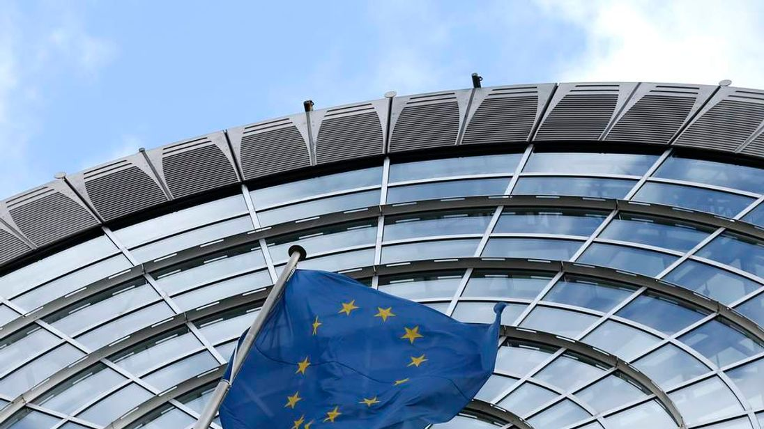 A European Union flag flutters outside of the European Parliament in Brussels