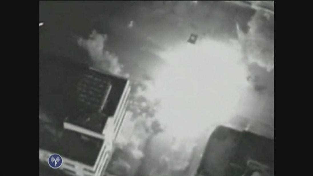 An image of Ahmed al Jaabari's car exploding after it was targeted