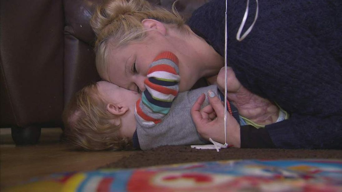 Tommy, who lost his hands and feet to meningitis, and mum Julie Tuckley