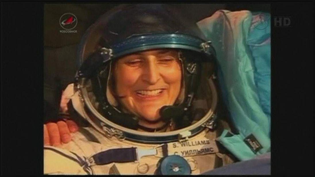 NASA astronaut Sunita Williams is helped from a Soyuz capsule