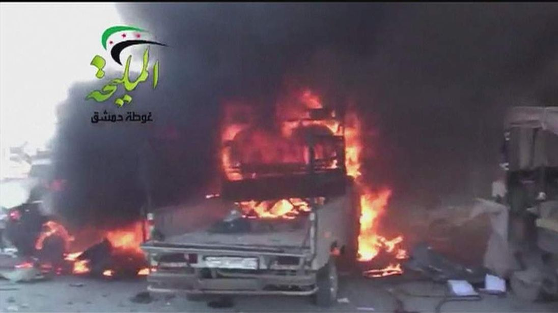 A vehicle is engulfed in flames at a petrol station in Damascus
