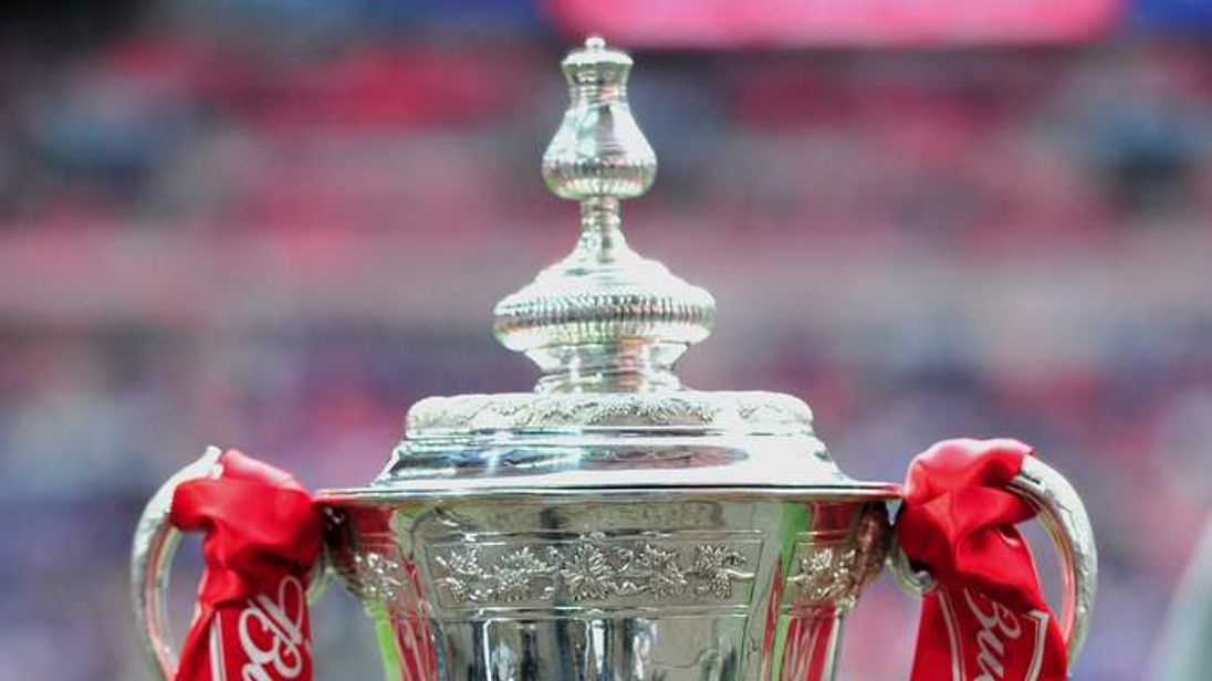 The FA Cup trophy on display before the