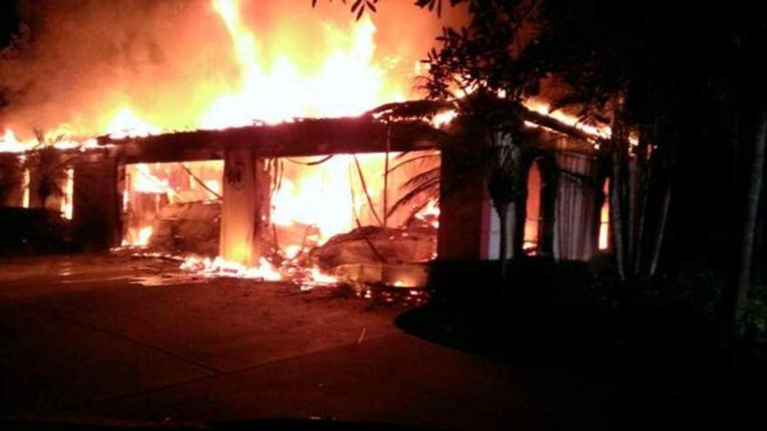 The burning mansion of former tennis star James Blake in Avila, Florida, on May 7 2014