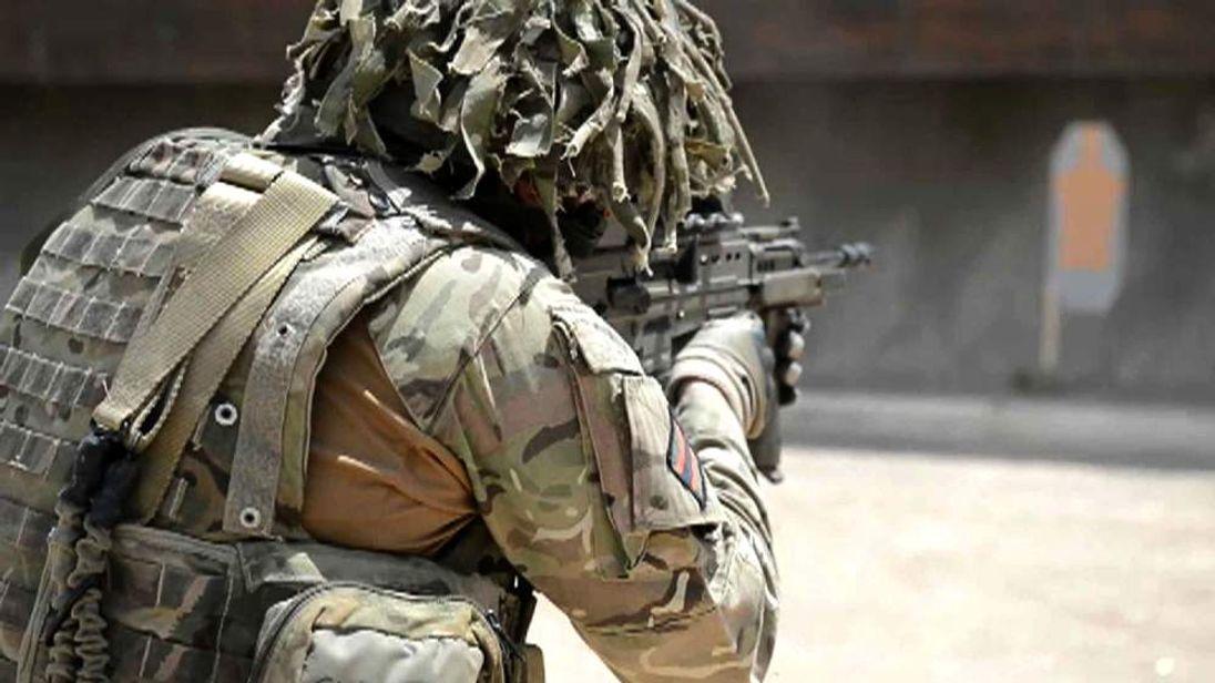 Soldier shooting practice.