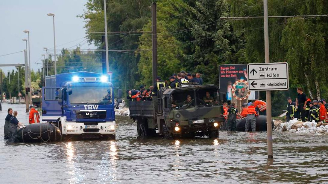 Volunteers in a flooded street in Magdeburg