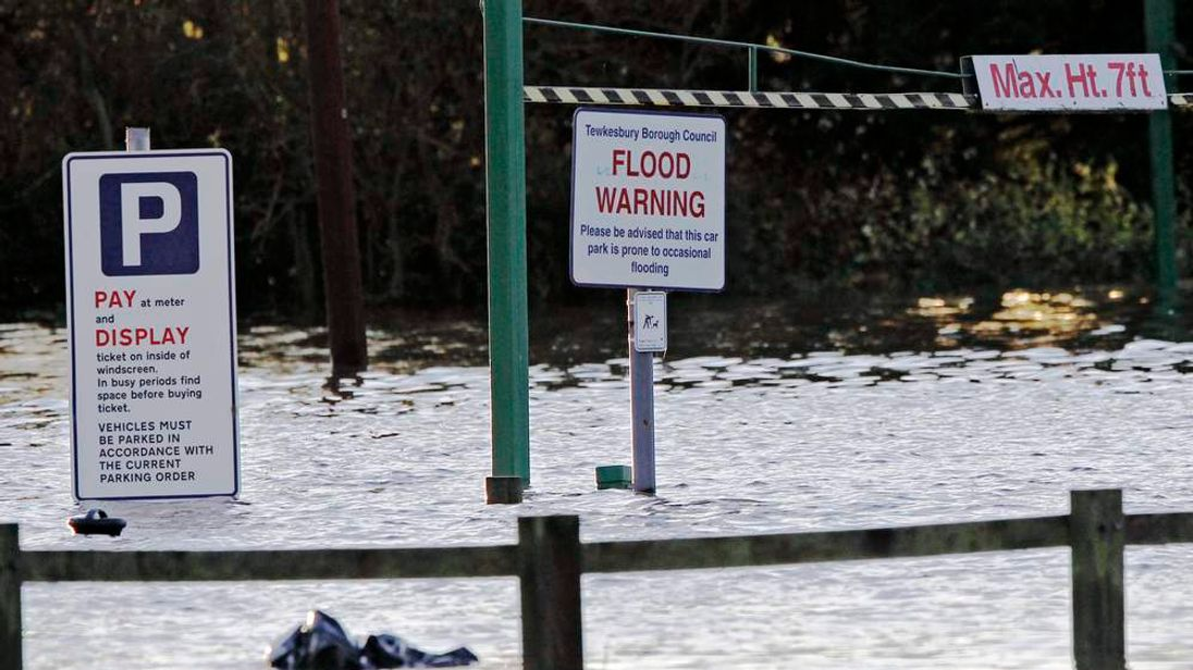 A sign in a car park warns of occassional flooding in Tewkesbury