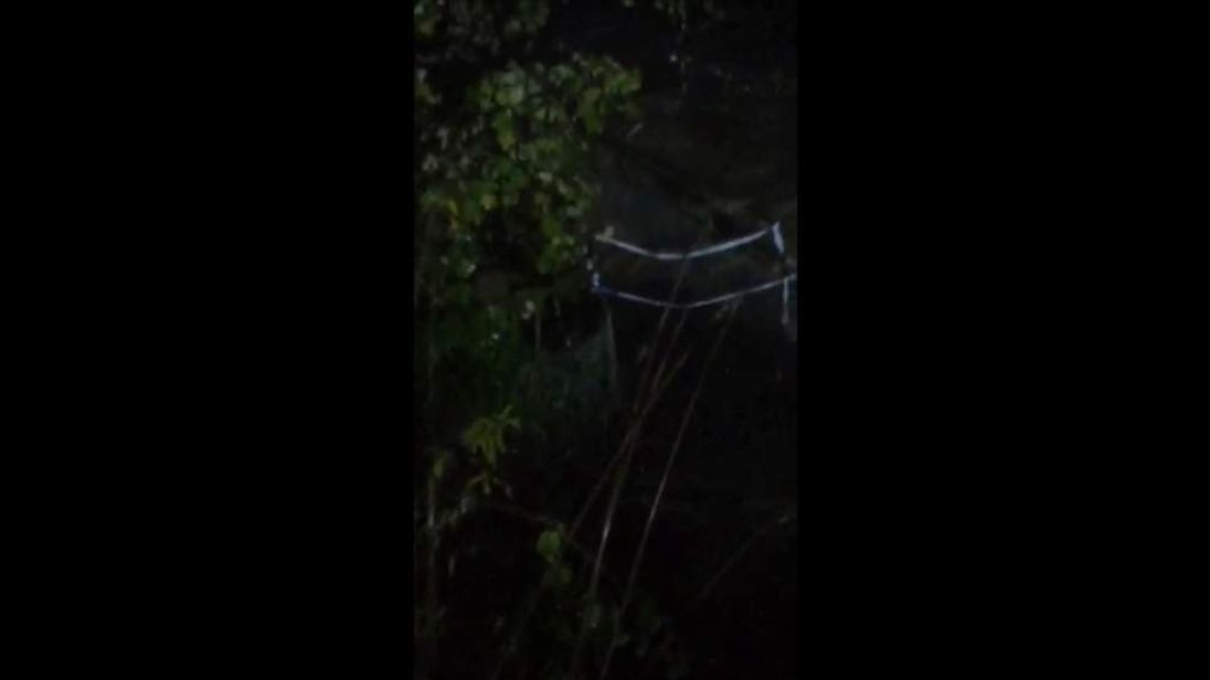 Footage of a footbridge in Keswick collapsing as a result of floods.