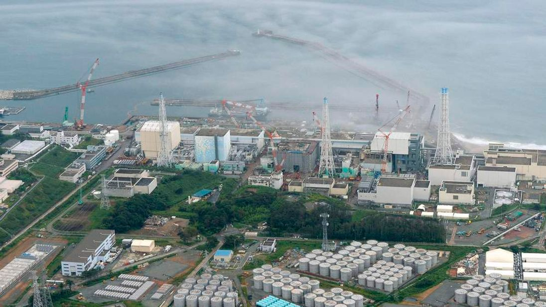 An aerial view shows TEPCO's tsunami-crippled Fukushima Daiichi nuclear power plant and its contaminated water storage tanks in Fukushima