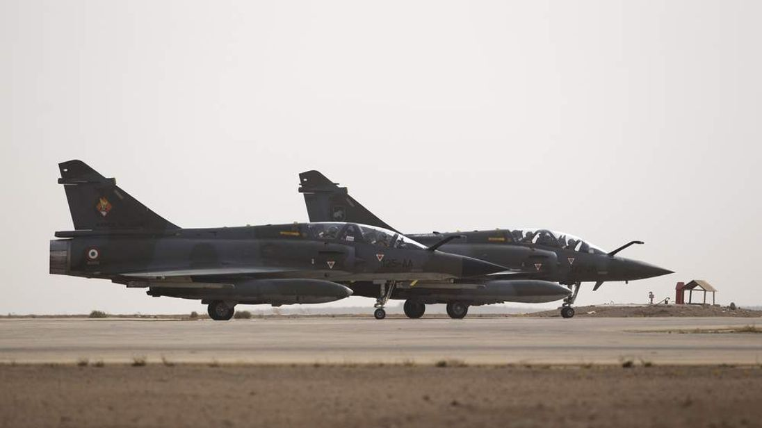 Two French army Mirage 2000 fighter jets prepare to take off