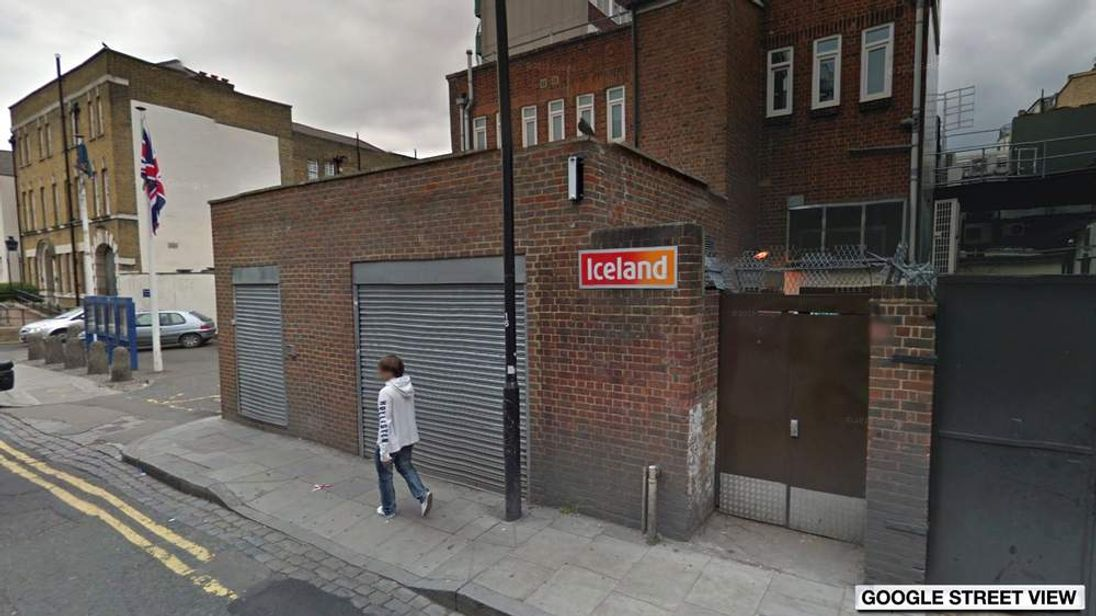 A Google street view image of the Iceland rear entrance in Kentish Town, with Kentish Town Police Station in the background (left)