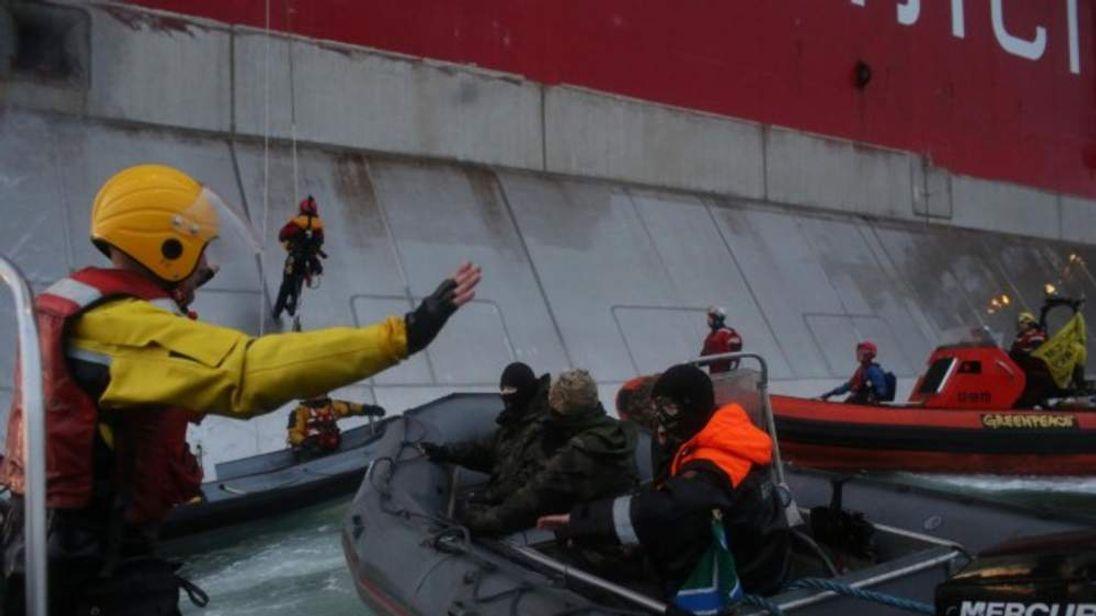 Armed Russian coastguard arrest two Greenpeace activists