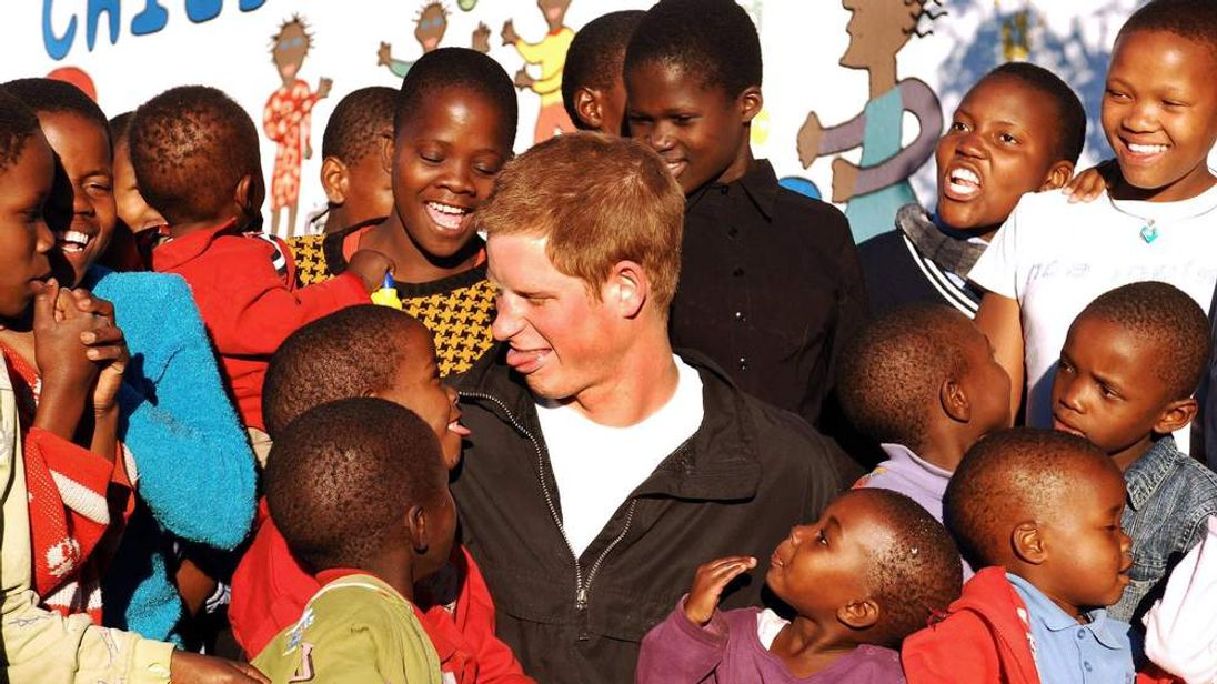 Prince Harry with children on a previous visit to Lesotho