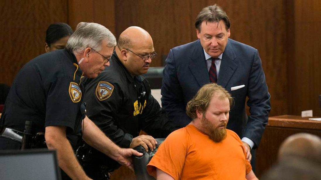 Accused mass shooter Ron Lee Haskell is wheeled from the courtroom after collapsing during a hearing in Houston
