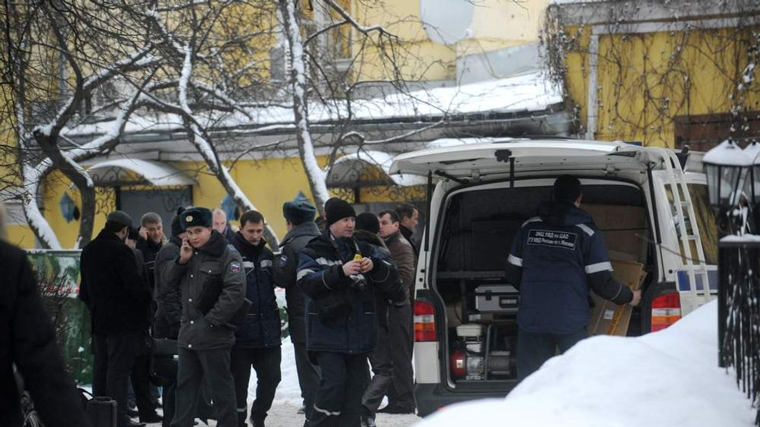 Police officers and investigators at the site of a killing of Aslan Usoyan