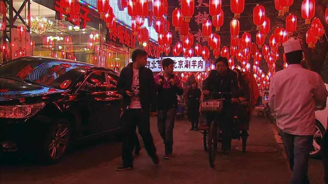 A rickshaw travels through a key eating area in Beijing