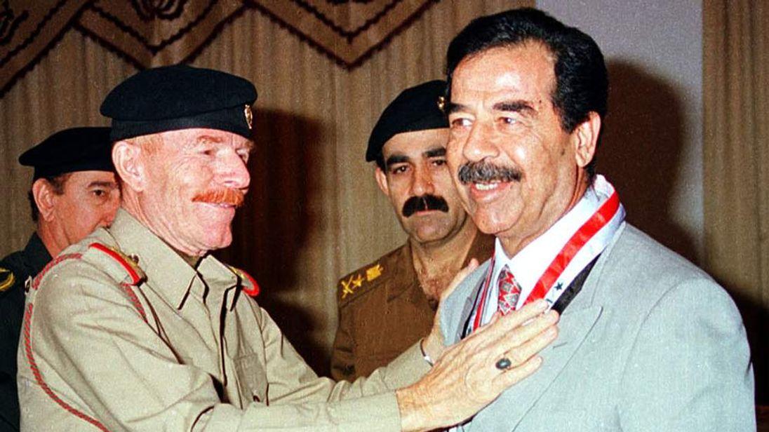 Saddam Hussein (R) and Izzat Ibrahim al Douri