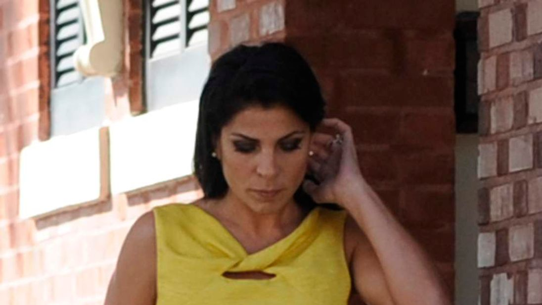 Jill Kelley, a friend of the Petraeus family, walks out of her home toward her car on Bayshore Boulevard in Tampa, Florida