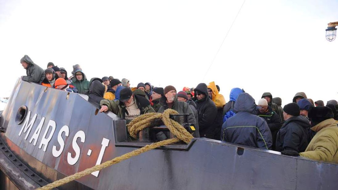Latvian fishermen are rescued from an ice floe