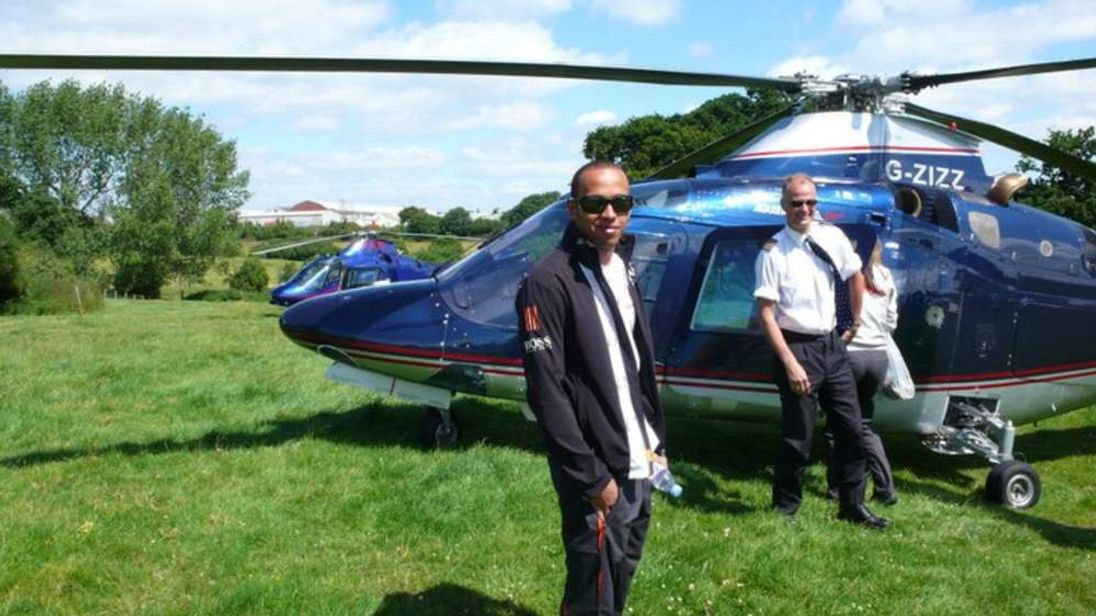 Pilot Pete Barnes with F1 driver Lewis Hamilton. Photo courtesy of RotorMotion