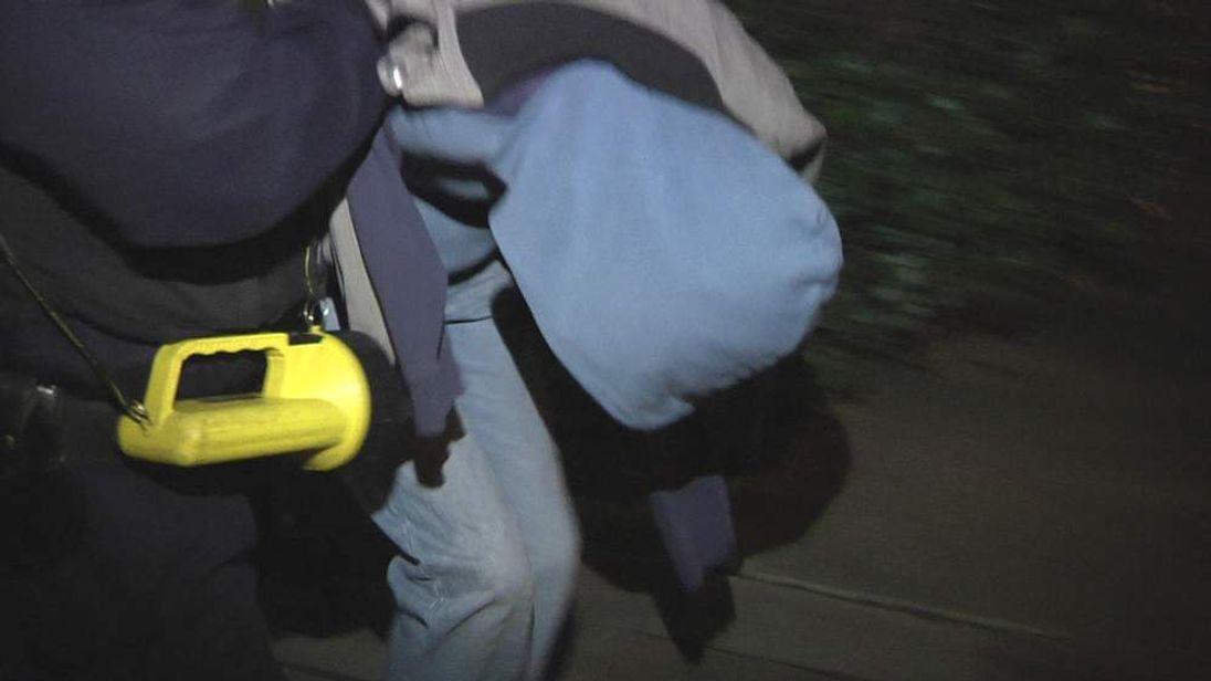 Man arrested in domestic violence raid