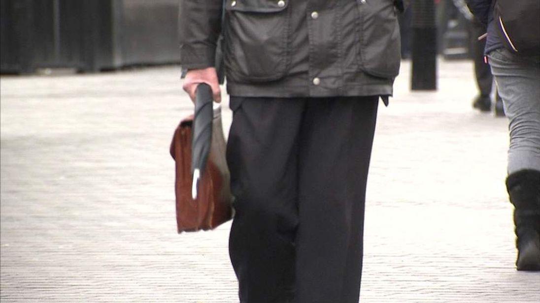 Unidentified man walking in westminster