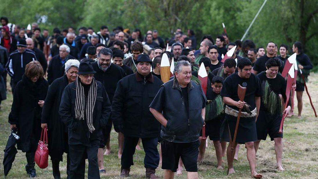 King Tuheitia walks to Waahi marae after arriving in a waka on October 8, 2012 in Huntly, New Zealand
