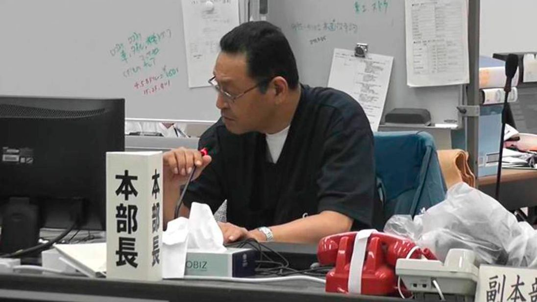 TEPCO's Fukushima Daiichi Nuclear Power Station's COO Masao Yoshida attends a general meeting at the Emergency Disaster Restoration Room in the plant in Fukushima prefecture