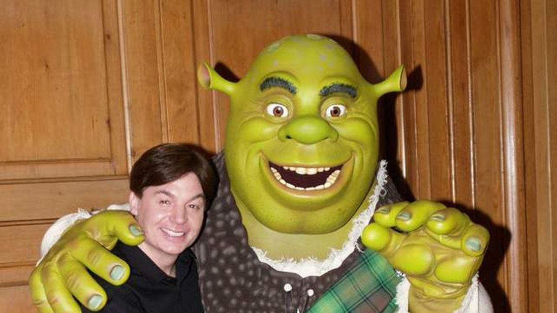 Canadian actor Mike Myers (L) poses with Shrek
