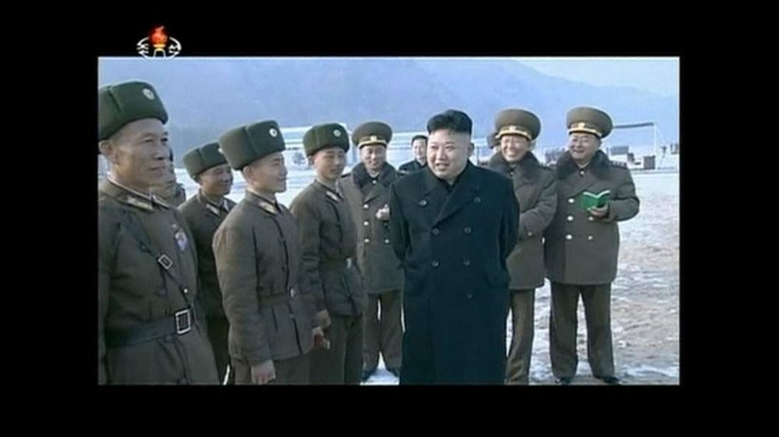 Kim Jong Un watches an artillery unit conduct missile shooting contest