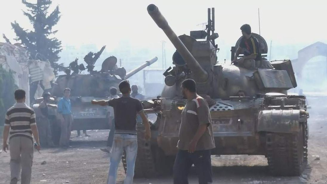 Syria anti government rebels with tanks at Anadan checkpoint north of Aleppo