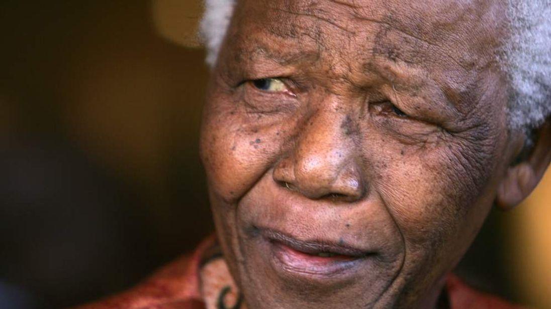 NELSON MANDELA ANNOUNCES HIS RETIREMENT FROM PUBLIC LIFE IN JOHANNESBURG.
