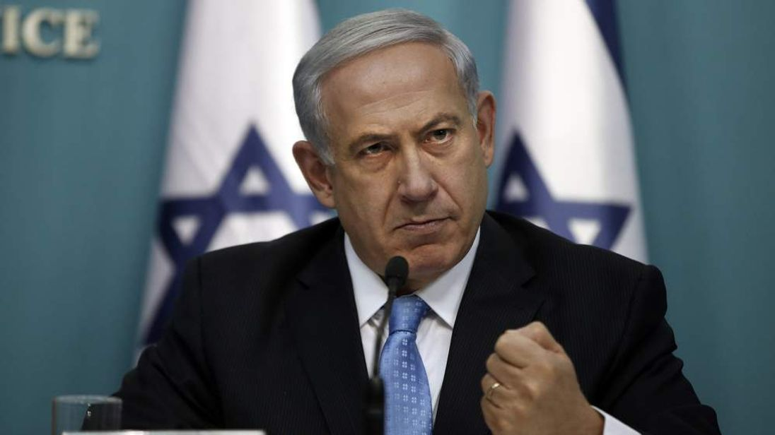 Israeli Prime Minister Benjamin Netanyahu gestures as he delivers a speech