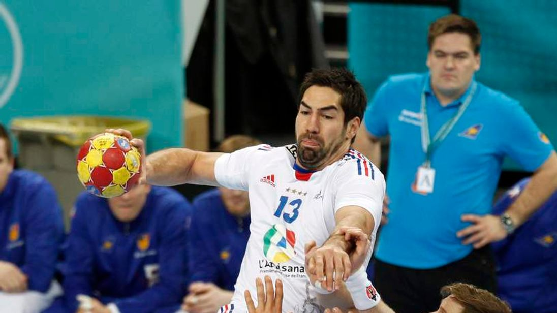 France's Karabatic attemps to score against Iceland's Jakobsson and Svavarsson during the World Men's Handball Championship at Palau Sant Jordi arena in Barcelona