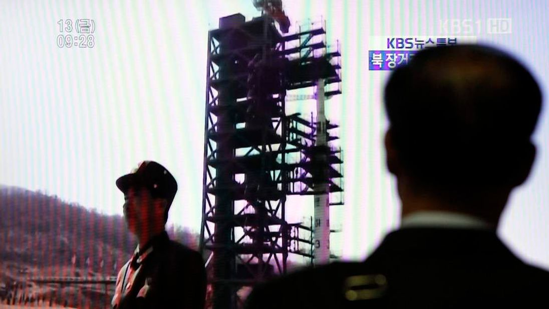 A South Korean passenger looks at a TV report on North Korea's rocket launch at Seoul railway station in Seoul