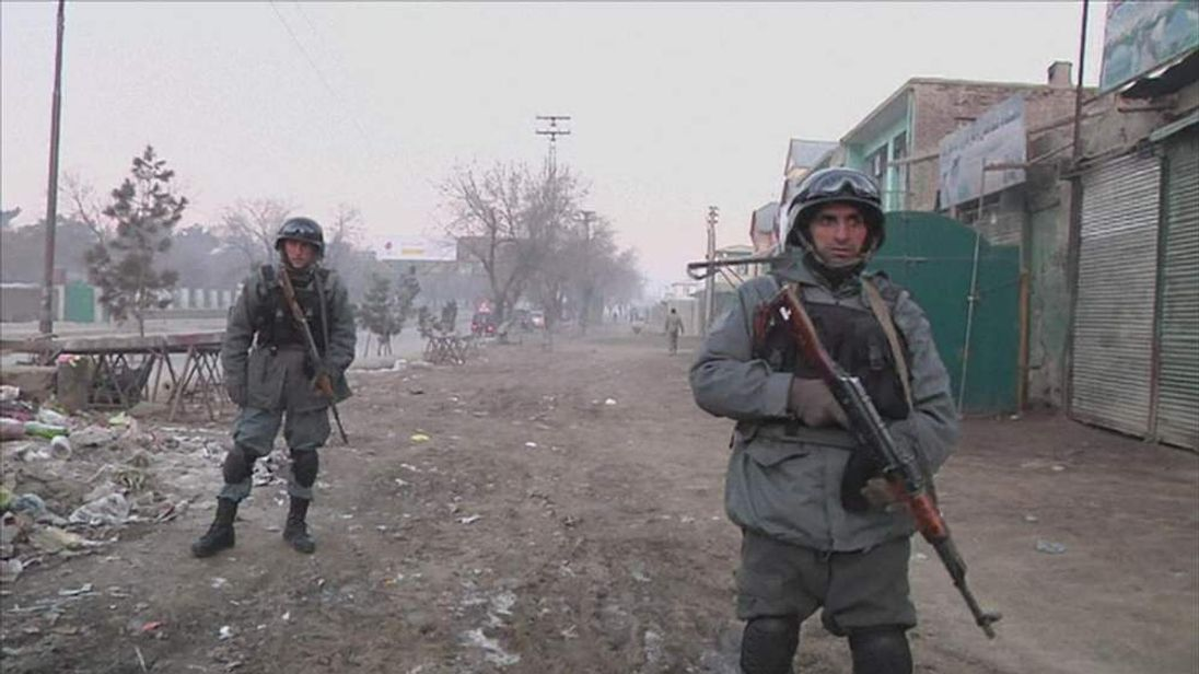 Police outside Kabul  barracks after Taliban suicide attack