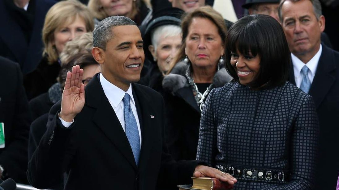 President Obama takes the oath at his inauguration on the steps of the US Capitol.