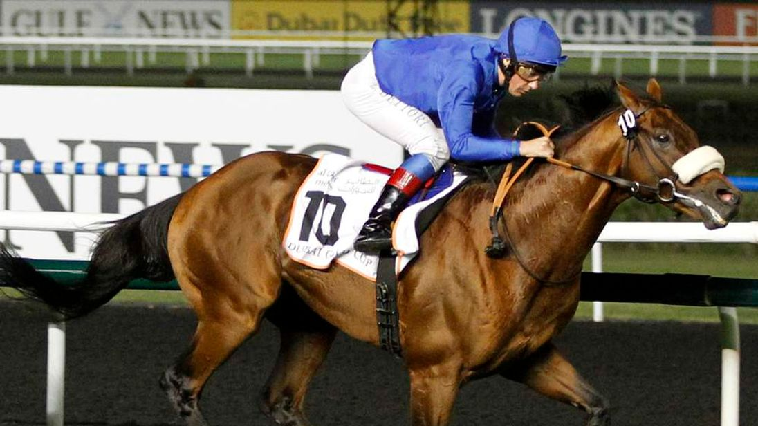Lanfranco Dettori, riding Opinion Poll, races towards the finish line during the third race of the 17th Dubai World Cup at the Meydan racecourse in Dubai