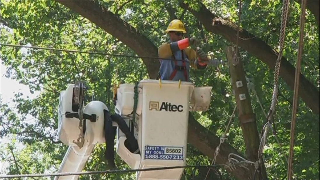 Engineer tries to restore power to homes after storms in Washington DC