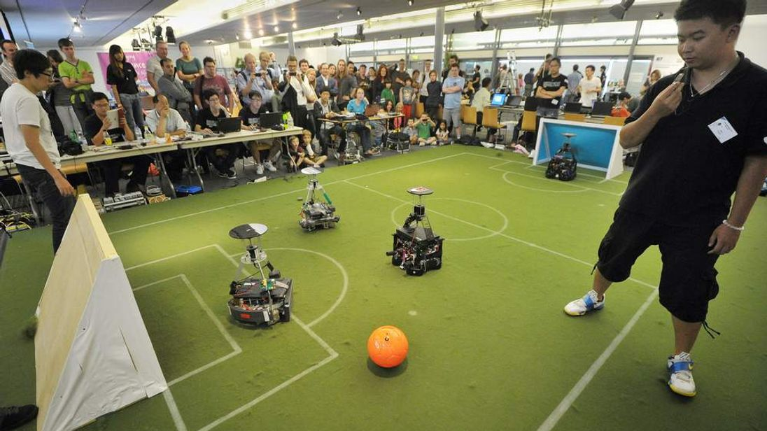 Teams from Taiwan and South Korea compete in the FIRA International RoboWorldCup in Bristol.